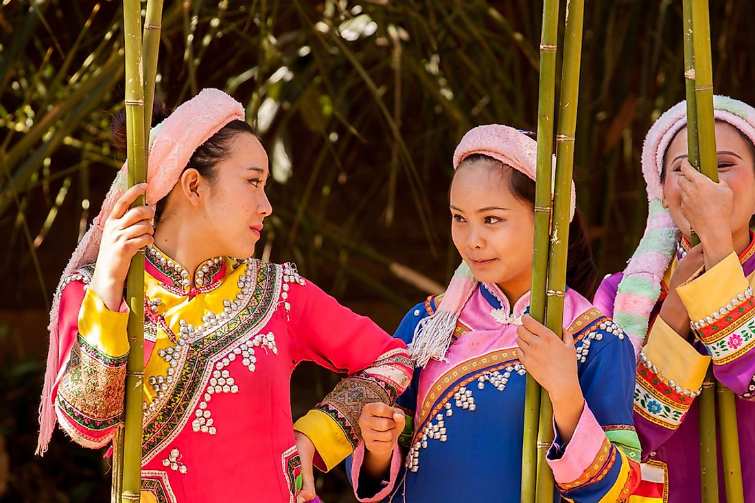 Lahu women after performing a traditional dance in Kunming, China. Editorial credit: Kasia Soszka / Shutterstock.com.
