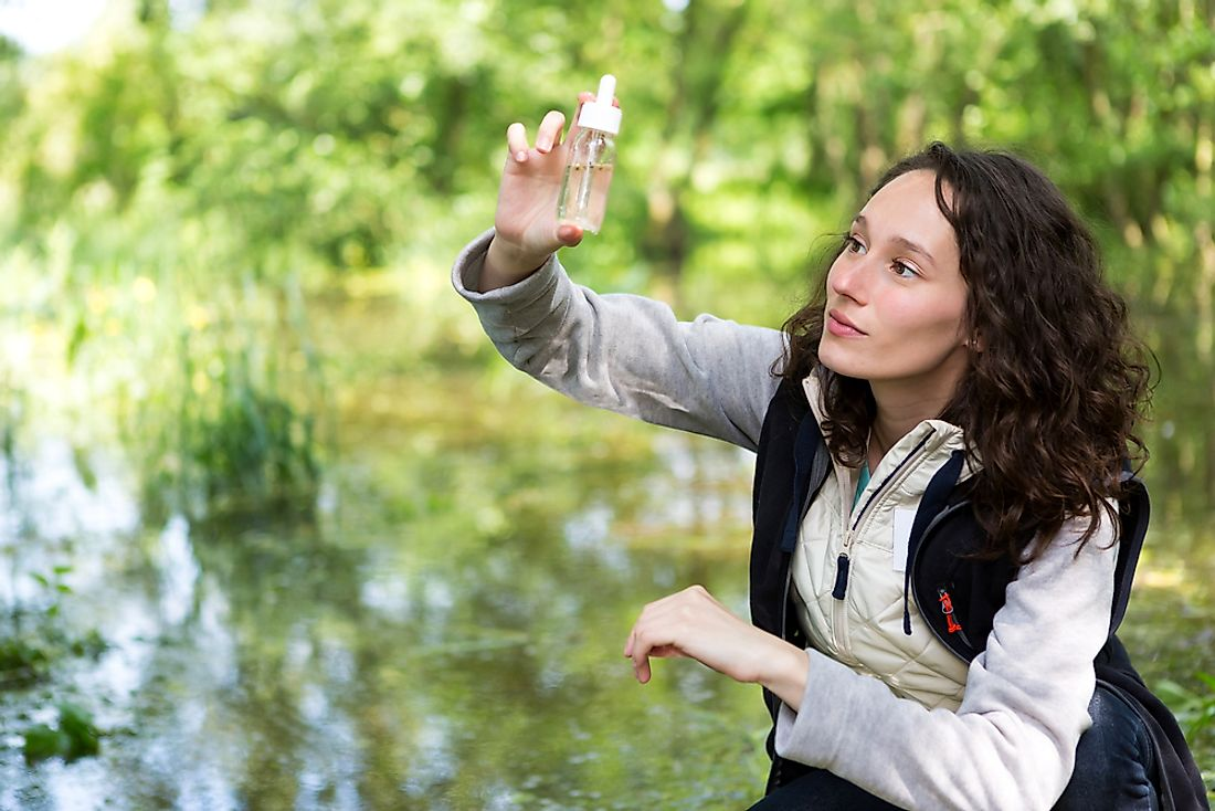 A biologist performing a water analysis.