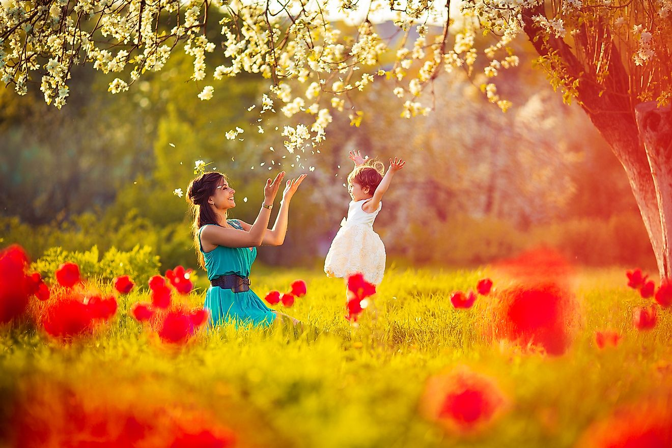 A mother and child celebrating the colors and blossoms of spring.