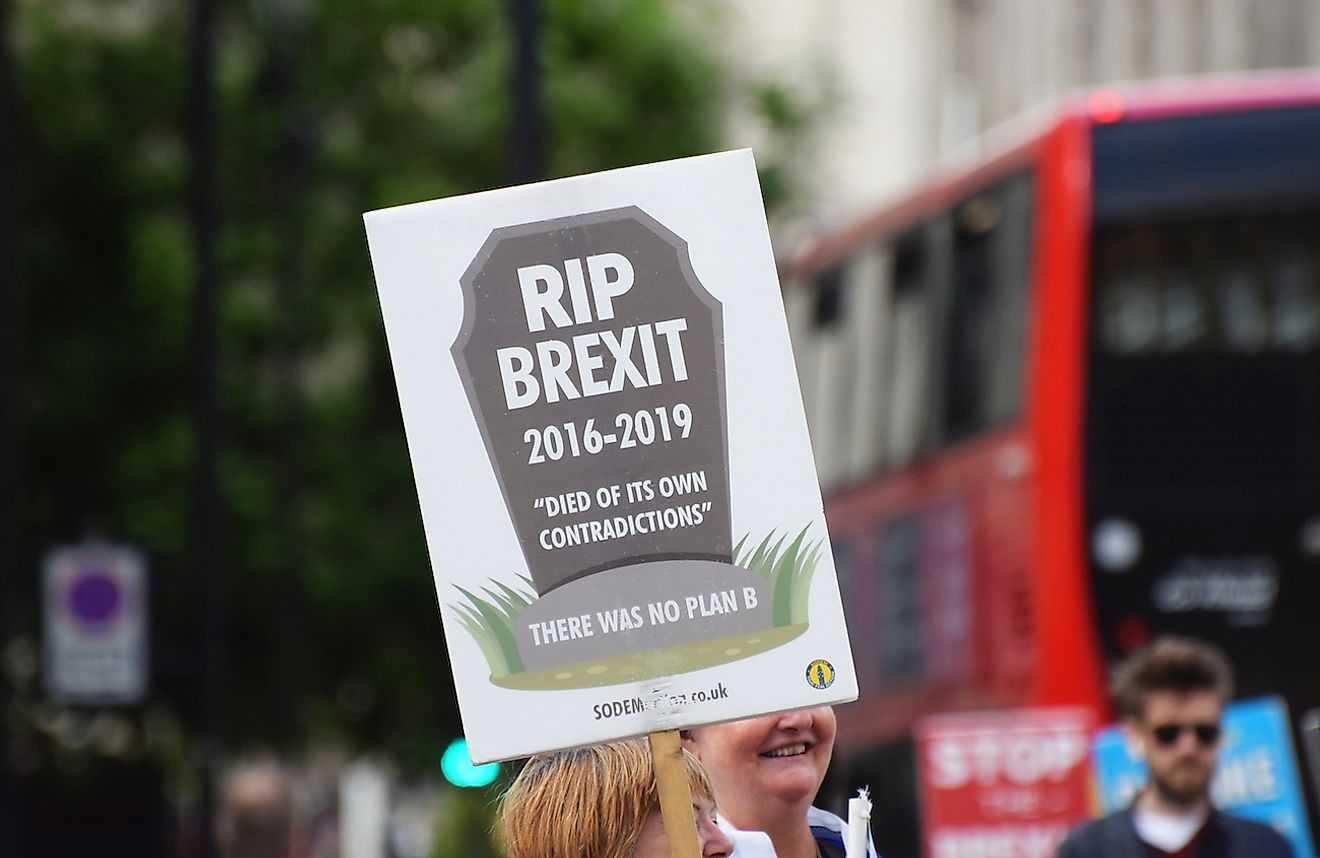 Westminster, London, UK. July 2 2019. A pro remain in the EU Brexit protestor holding a banner stating '`RIP Brexit 2016 - 2019 died of its own contradictions. Image credit: Amani A/Shutterstock.com
