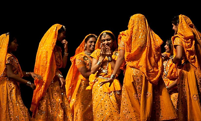 Indian folk dancers in the traditional lehenga-choli costume.