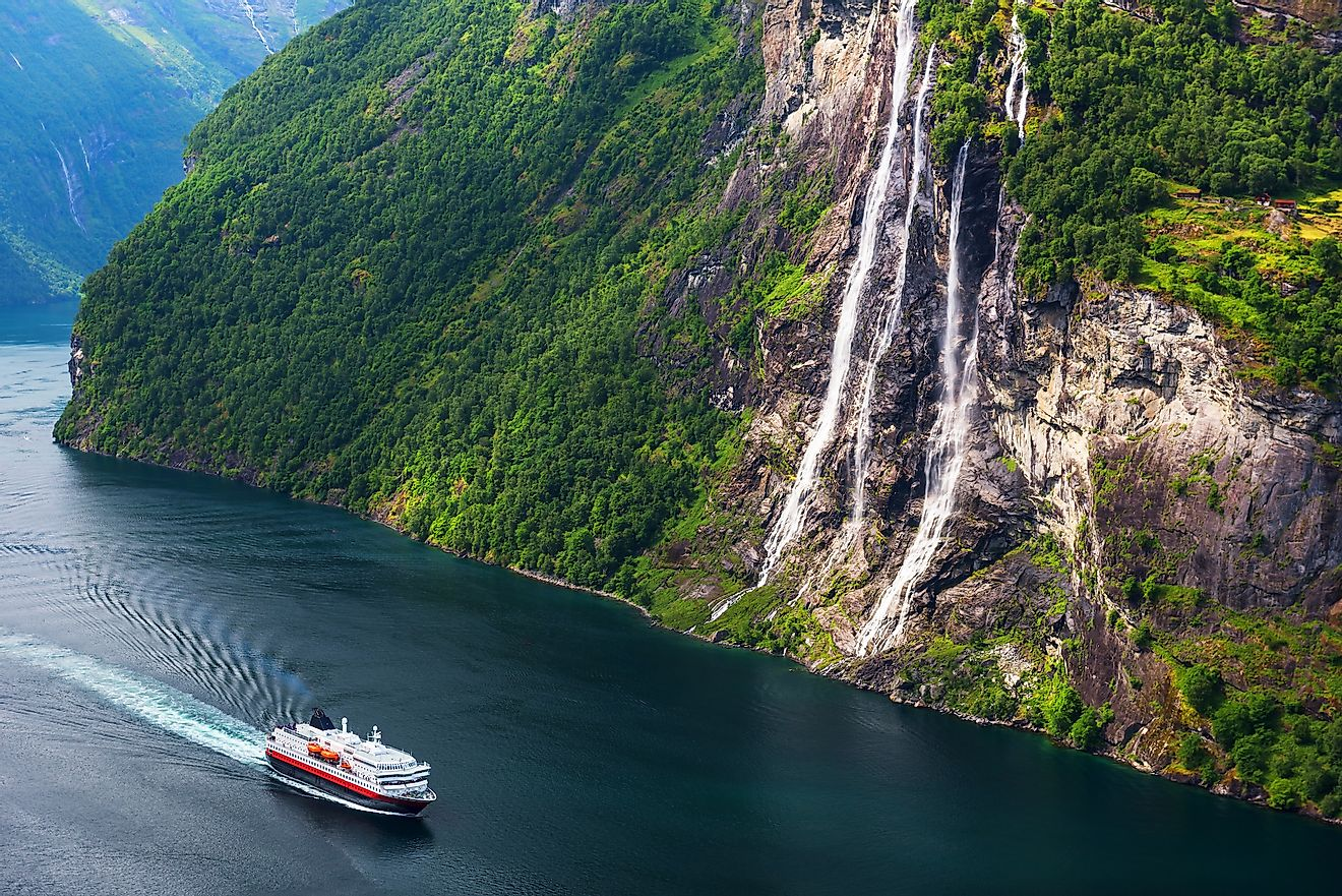 Breathtaking view of Sunnylvsfjorden fjord and famous Seven Sisters waterfalls, near Geiranger village in western Norway. Image credit: Smit/Shutterstock.com