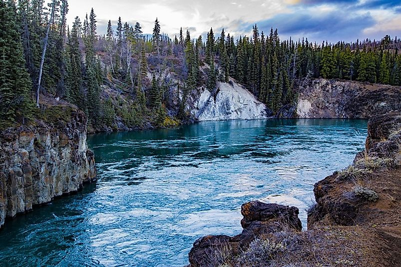 The breathtaking Miles Canyon (pictured) was formed from volcanic activity along the Yukon River.