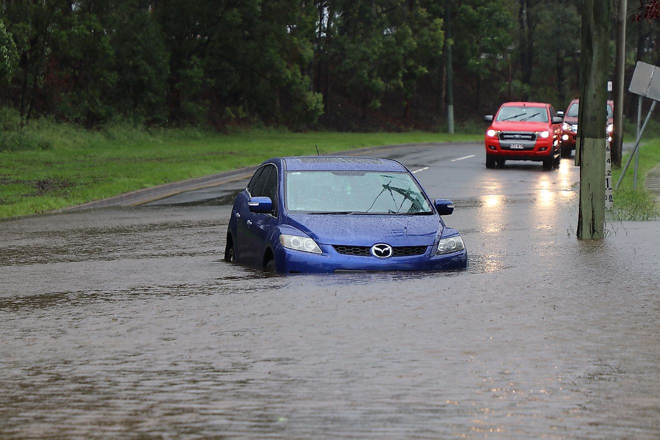 Car stuck in the suburb of Rocklea, Brisbane, Australia in floodwater from huge rainfall as a result of Tropical Cyclone Debbie. Image credit:  Igor Corovic/Shutterstock.com