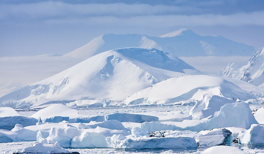The higher elevation of the South Pole contributes to its cold temperatures.