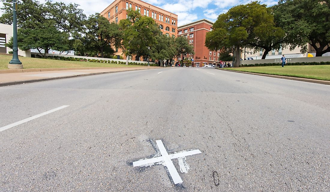 "An ""X"" marking the spot where President Kennedy was assassinated in Dallas, Texas. Editorial credit: Allen.G / Shutterstock.com"