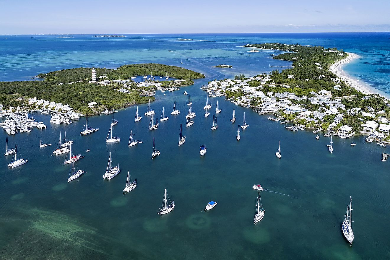 Aerial view of the harbour and lighthouse in Hope Town on Elbow Cay off the island of Abaco, Bahamas. Image credit: pics721/Shutterstock.com