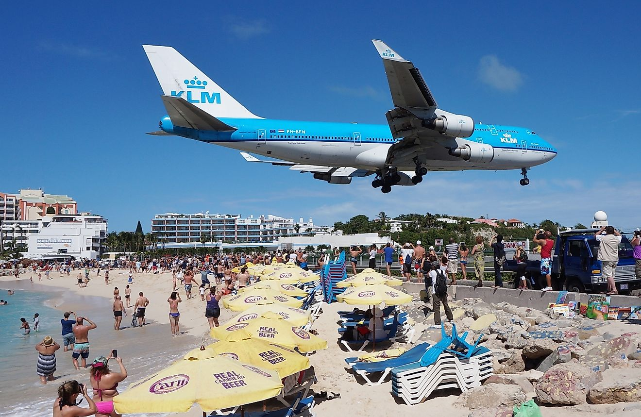 The beach at Maho Bay is one of the world's premier planespotting destinations. Airplanes landing at the Princess Juliana Airport fly over beachgoers. Image credit:  EQRoy/Shutterstock.com
