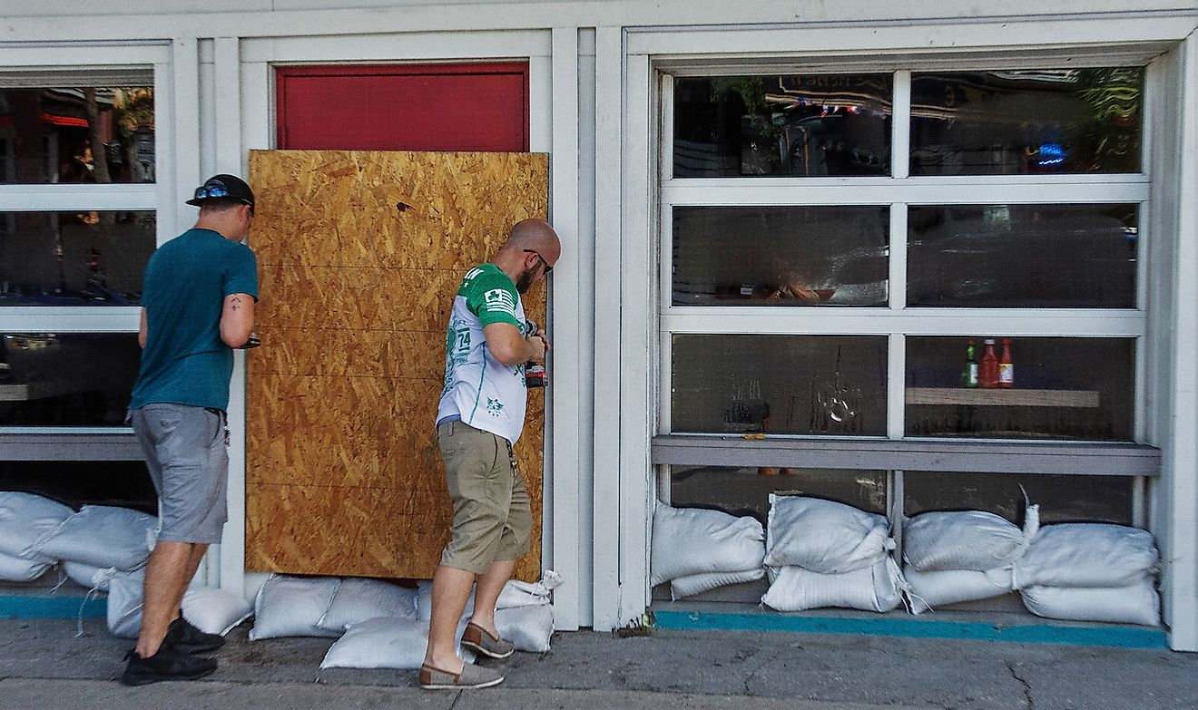 Workers board windows at a restaurant in preparation for Hurricane Florence. Image credit: Prentiss Findlay/Shutterstock.com