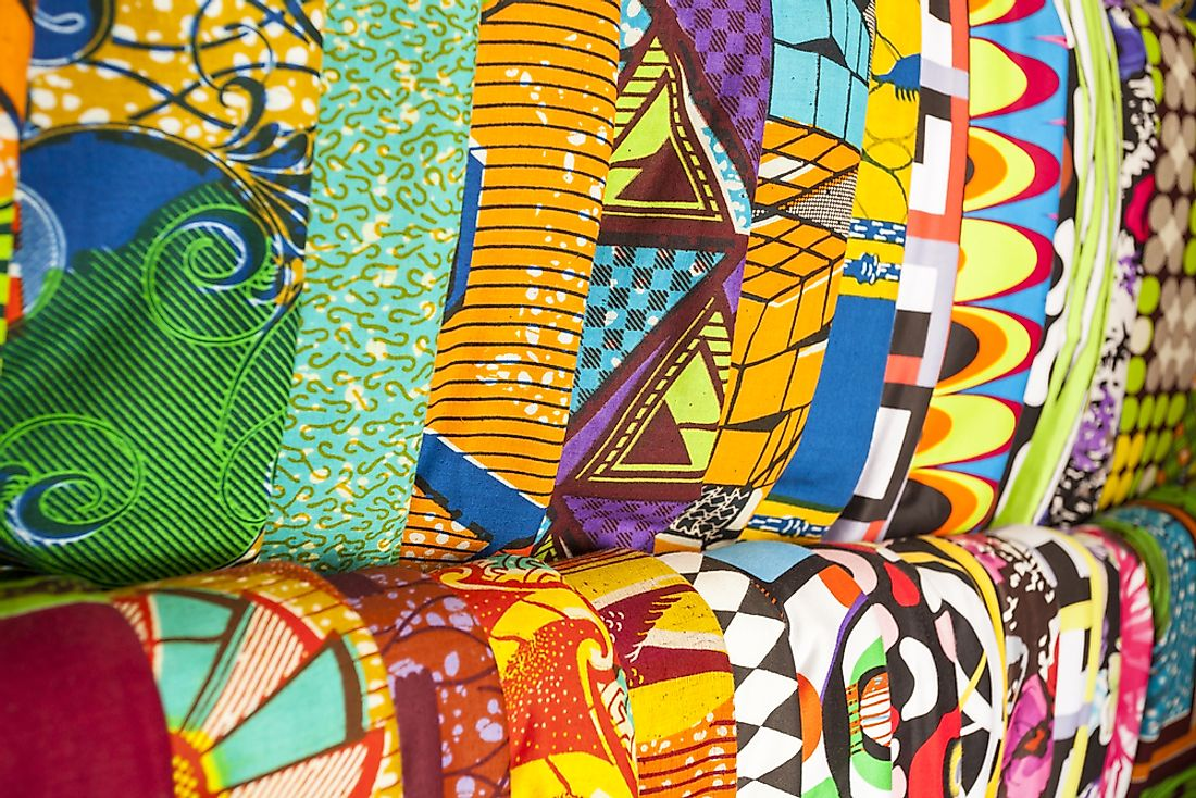 Traditional fabrics sold in a marketplace in Ghana.