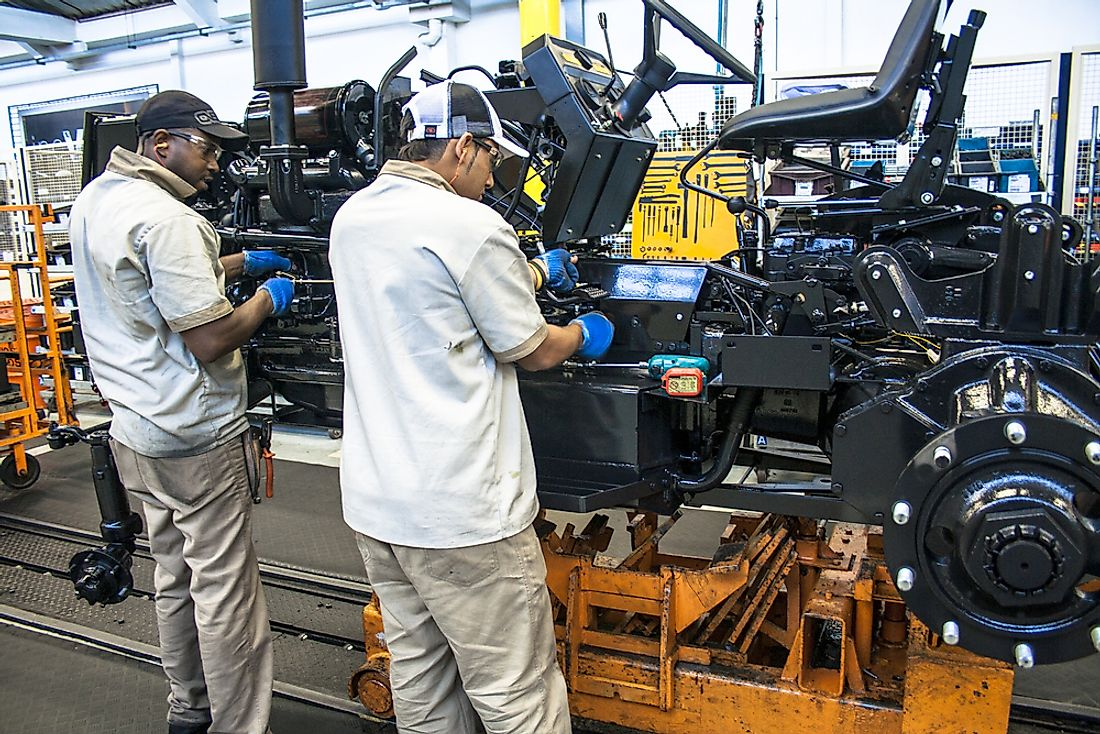 Workers tend to a vehicle assembly line in Sao Paulo, Brazil. The automobile industry is a major component of Brazil's economy. Photo credit: Alf Ribeiro / Shutterstock.com.