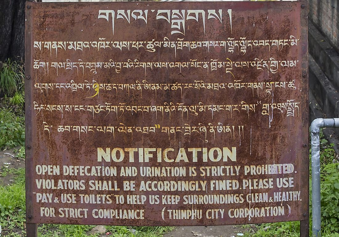 A sign in English and Dzongkha. Editorial credit: PiercarloAbate / Shutterstock.com.