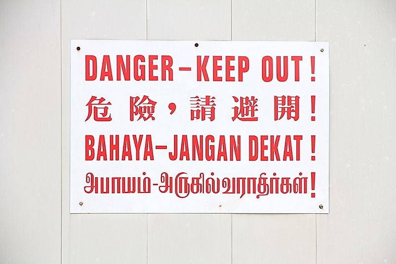 This sign in Singapore warns people in Mandarin Chinese, English, Malay, and Tamil.