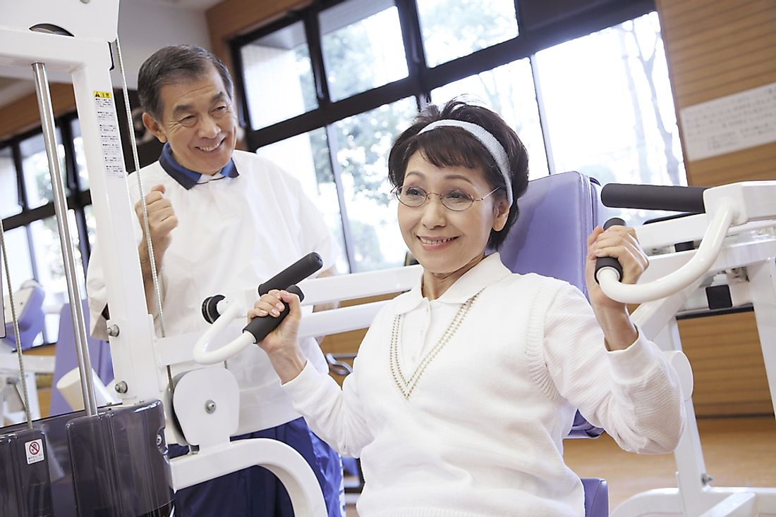 An elderly Japanese couple hitting the weights. Home to many supercentenarians, 26.3% of the island nation's population is 65 years of age or older.