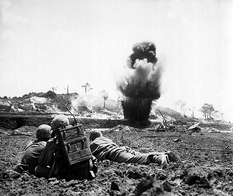 A U.S. Marine Corps demolition crew destroys a Japanese position during the Battle of Okinawa.
