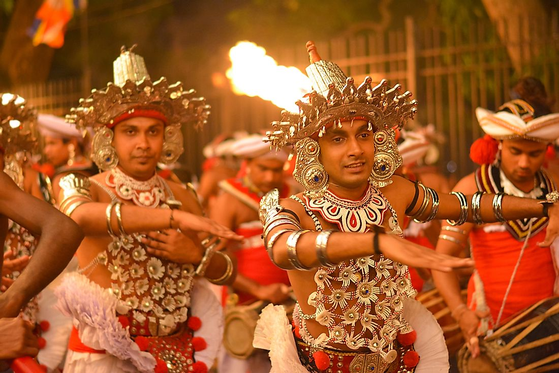 Performers are the Kandy Esala procession in Kandy, Sri Lanka.  Editorial credit: SamanWeeratunga / Shutterstock.com.