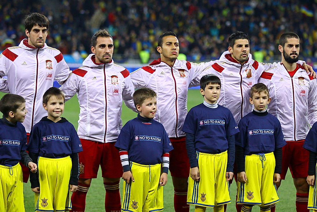 The Spanish national football team stands for the Spanish national anthem. Editorial credit: katatonia82 / Shutterstock.com