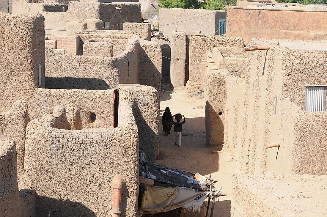 The Old Town fo Djenné, in Mali, is listed as a UNESCO World Heritage Site in danger. Editorial credit: Claudiovidri / Shutterstock.com.