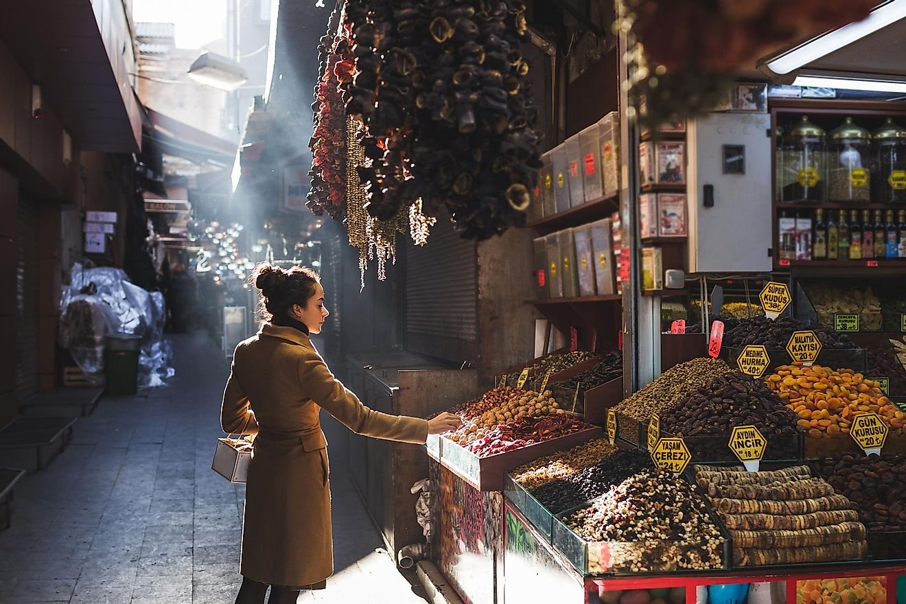 A person picks out dried good in the Grand Bazaar Market in Istanbul, Turkey. Image credit:  Breslavtsev Oleg/Shutterstock