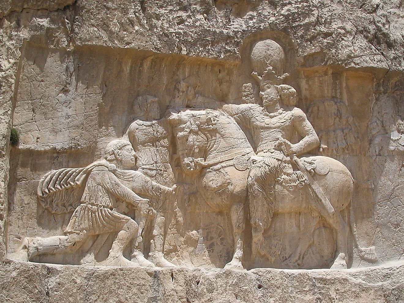 A rock-face relief at Naqsh-e Rostam, depicting the triumph of Shapur I over the Roman Emperor Valerian and Philip the Arab. Image credit: Fabienkhan/Public domain