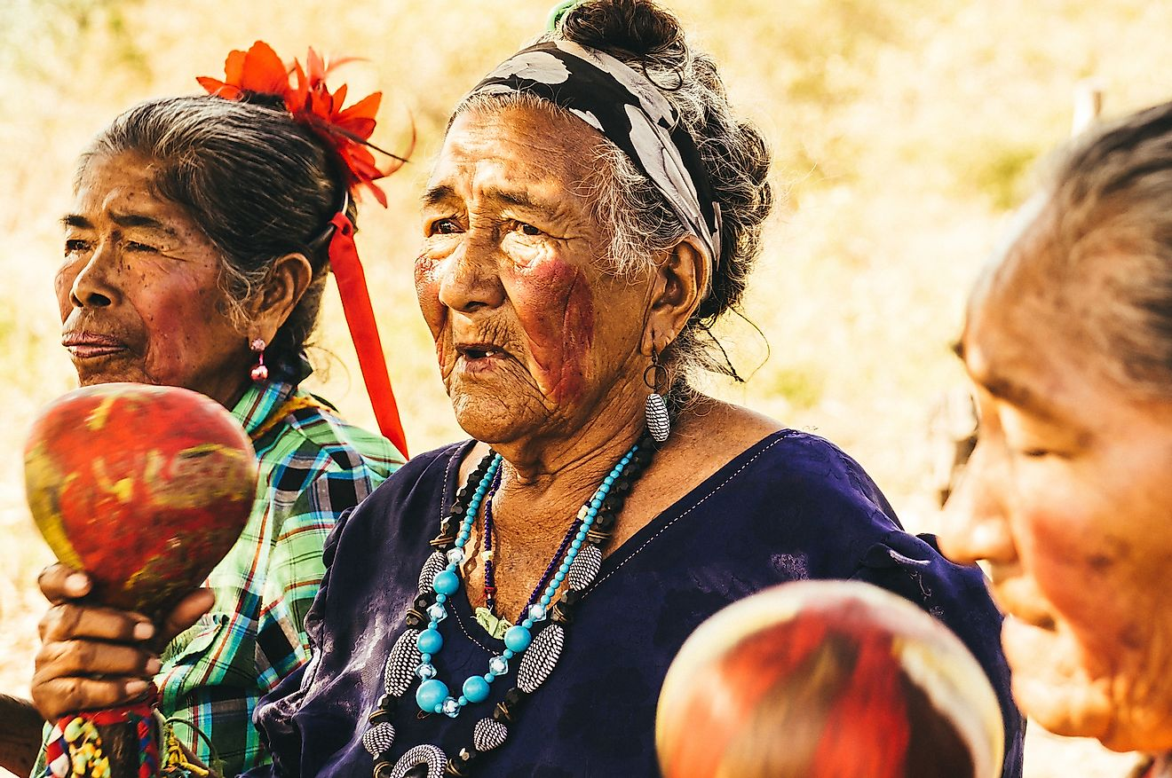 Paraguayan indigenous Guarani women perform a song. Image credit: Julian Peters Photography/Shutterstock.com