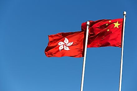 Flags of Hong Kong and China. Image credit: Daniel Fung/Shutterstock.com