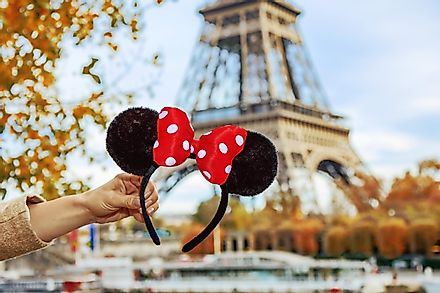 Minnie Mouse ears in front of the Eiffel Tower.