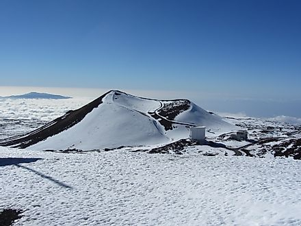 A volcanic crater covered in snow on the Big Island of Hawaii.