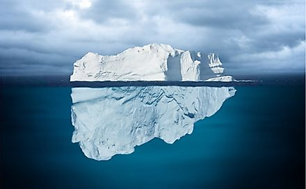 The greater mass of the iceberg floats below water.