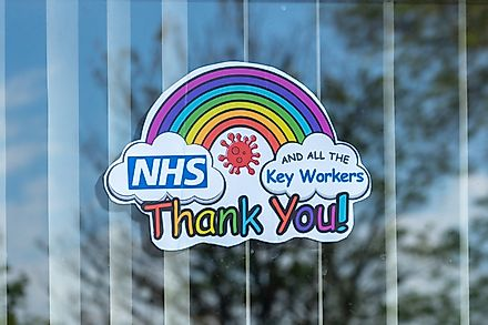 A rainbow in a house window to thank the NHS and key workers during the Coronavirus or Covid-19 Isolation. Image credit: Gary L Hider/Shutterstock.com