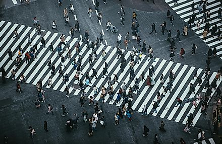 People crossing the street in Tokyo. Image credit: oneinchpunch/Shutterstock