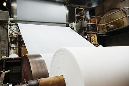 Industrial paper-making machinery at a pulp and paper plant production plant.