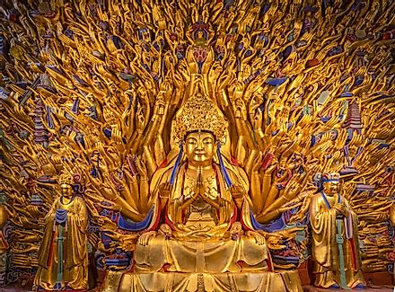 Golden sculpture of Avalokiteshvara Buddha or Guanyin with thousand hands at Dazu Rock Carvings at Mount Baoding or Baodingshan in Dazu, Chongqing, China. Image credit: NG-Spacetime/Shutterstock.com