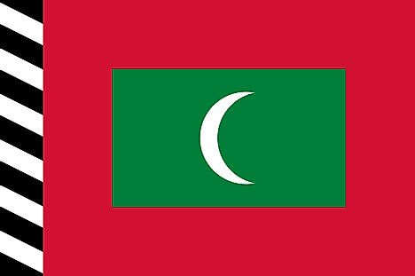 Red flag with black and white striped hoist and a green rectangle containing white crescent