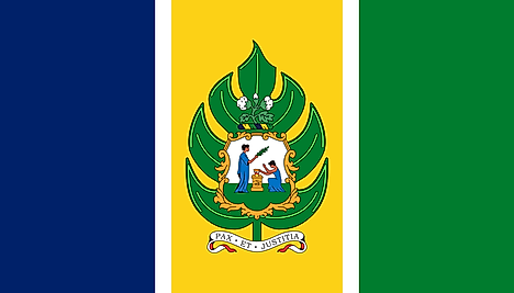 Blue, yellow, and green vertical bands separated by thin white stripes and the national emblem centered on yellow