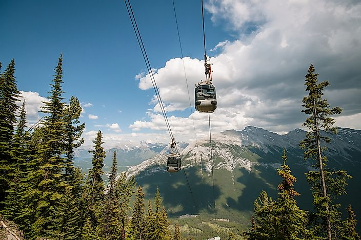 Gondolas traveling up Sulphur Mountain.