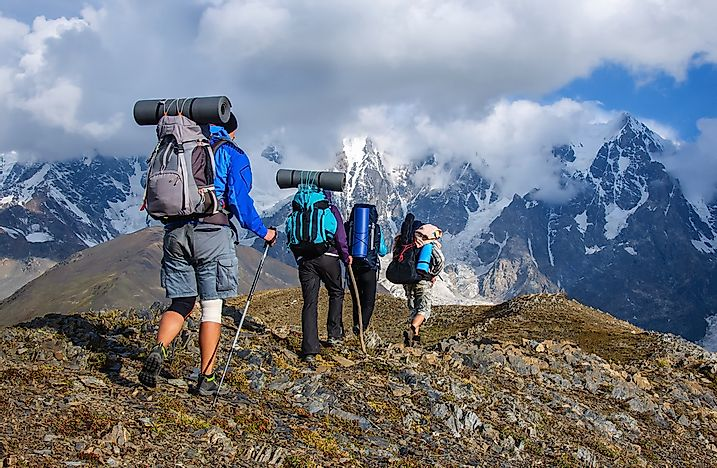 Tourists hiking in the mountains of Georgia.