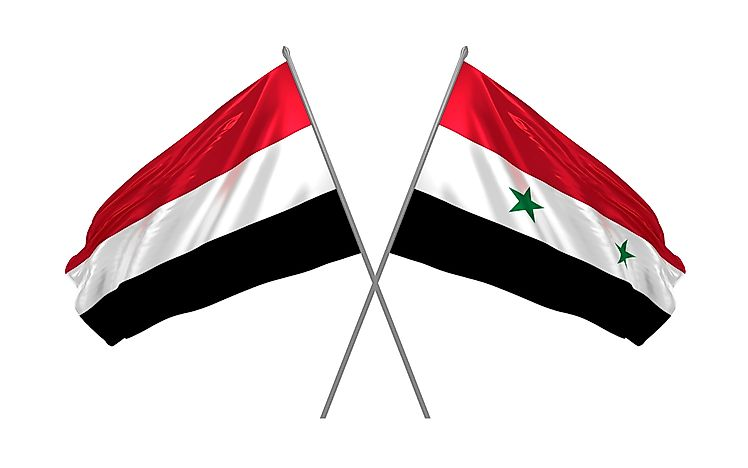 The flag of Yemen, left, and the flag of Syria.