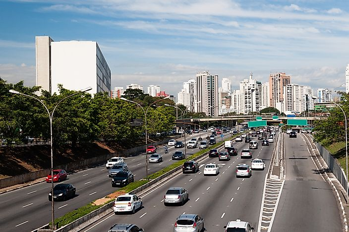 Traffic in Sao Paulo moving steadily, although the high volume of cars could quickly cause congestion.
