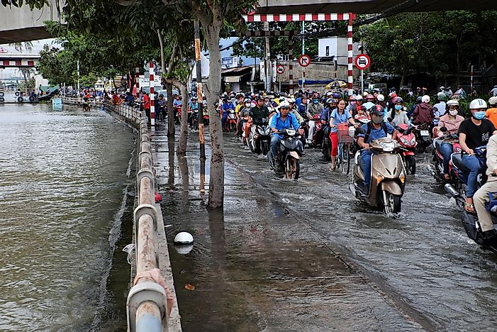 Editorial credit: xuanhuongho / Shutterstock.com. Flooded streets in Ho Chi Minh City, Vietnam.