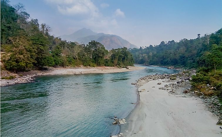 The Manas River separating the Royal Manas National Park, Bhutan, from India's Manas National Park.