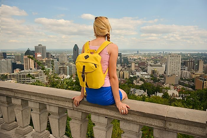A student looks out upon the skyline of Montreal.