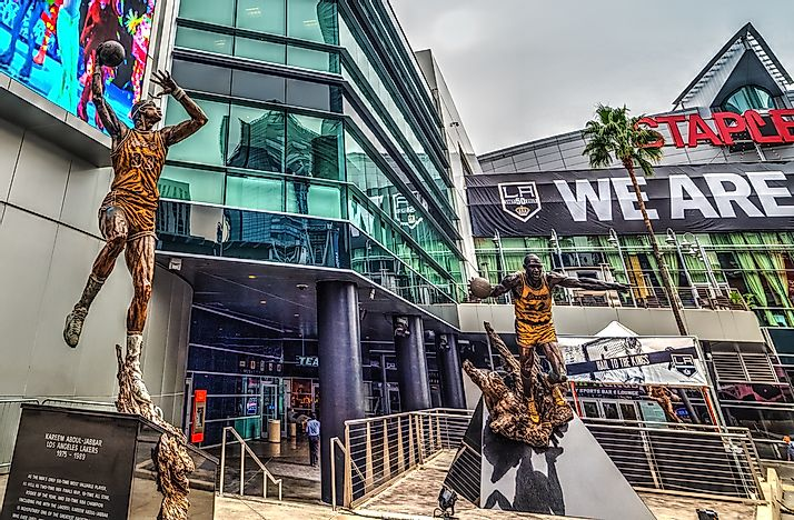 Statues of former Lakers and NBA legends Kareem Abdul-Jabbar and Magic Johnson outside the Staples Center.  Editorial credit: Gabriele Maltinti / Shutterstock.com