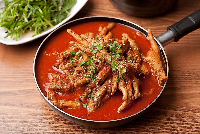 A Korean pub dish consisting of spicy chicken feet.