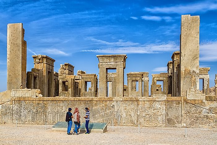 Tourists at Persepolis UNESCO World Heritage Site, Iran. Photo credit: Milosz Maslanka / Shutterstock.com.