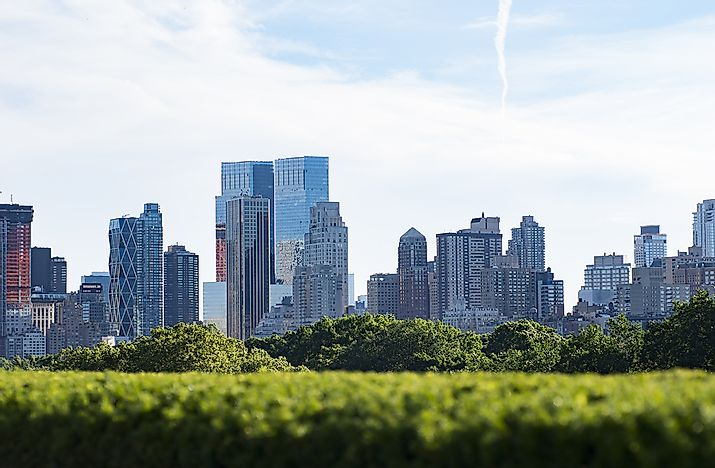 New York with the green rooftop of the Met in the foreground.