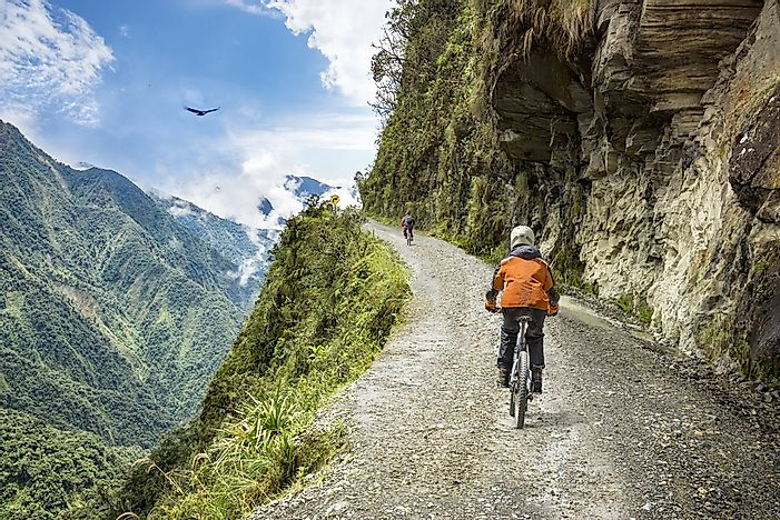 Tourists bicycle through the mountains of Bolivia.
