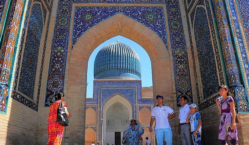 Travelers tour the Bibi-Khanym Mosque in Uzbekistan. Photo credit: Natalia Davidovich / Shutterstock.com.