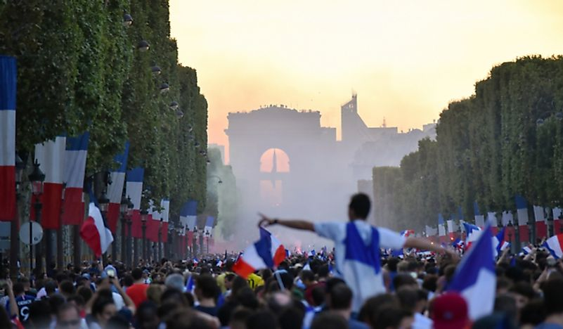 Triumphant France parade Fifa World Cup trophy down Champs Elysees