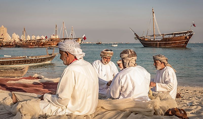 Men making fishing nets for the Dhow festival in Doha, Qatar.  Editorial credit: ibrar.kunri / Shutterstock.com
